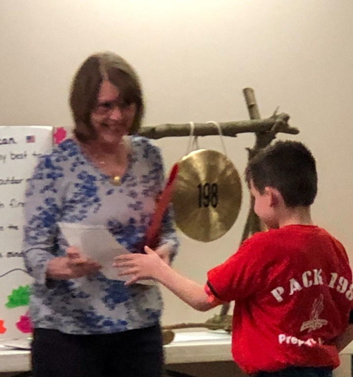 Earth Day celebration Poster Contest Winner accepts 1st Place certificate from The Garden Club Federation of PA.